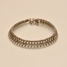 Avni's beautiful silver toned anklets studded with white kundhan, antique beads and pearls - Online Shopping for Anklets by Avni Collections