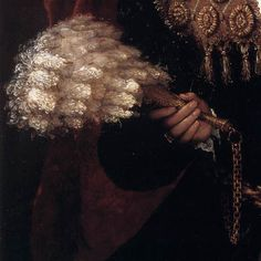 Some details from portraits of women and girls in the 16th and early 17th centuries showing some different styles of feather fans.