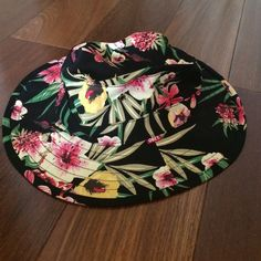 Obey  Floral Bucket Hat Black with cool multicolor flower designs. Obey, worn once. Has leather strings for tightening and adjusting Obey Accessories Hats