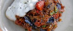 Spiced aubergine and tomatoes with yogurt.