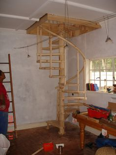 spiral stairway   Cape Stairs: D.I.Y Spiral Staircase with round balusters and rail