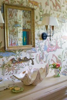 We are inspired by the wallpaper in this bathroom.
