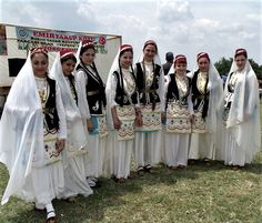 A group of Crimean Tatar dancers from the village of Emiryakup  Köyü (Hayrabolu district, Tekirdağ province), wearing traditional costumes.  Clothing style: first half of 20th century.  These are recent workshop-made copies, as worn by folk dance groups.