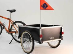 Our Cargo Buddy has a large box and carrying capacity of up to 100lbs. Rigid plastic and ultra-light bike trailer design.
