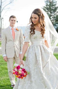 Elbow sleeve modest wedding dress by Alta Moda Bridal.   photo: Cascio Photo