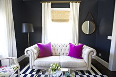 #office, #modern, #stripes, #living-room, #sofa, #rug, #paint-color, #tufted, #pink, #black-and-white, #mirror, #black, #pillow  Photography: Brooke Palmer - vogoimage.com/  Read More: http://www.stylemepretty.com/living/2014/02/05/san-clemente-home-tour-with-shea-mcgee/