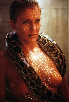 Joanna Cassidy (Zhora) was at ease with the snake around her neck because it was her pet, a Burmese python named Darling.