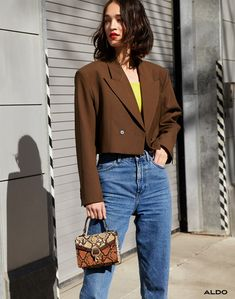 Mini bags make a big style statement, especially in mixes of prints, textures and tones. Whether it's a cross-body chain for the girl on the go, or a top-handle bag for a sophisticated touch, these bags are made to be worn and re-worn no matter the occasion.