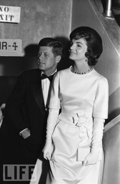 "Jackie selected the designer Oleg Cassini to create many pieces in her wardrobe, including her hats, her bags, and this gorgeous gown, which she wore to an inaugural concert in January 1961. (Just two months after giving birth to John Jr., she is stunningly slim.) The new first lady, however, designed her own inauguration ball gown; according to LIFE, it made her ""resemble both a fairy princess at a fancy dress ball and a little girl enjoying her first party."""