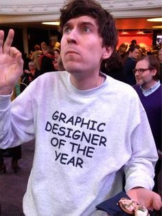 This guy won graphic designer of the year. He responded by making himself a tshirt. Using Comic-sans font. Brilliant. - Imgur