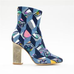 Acollaboration between Beau Coops designer Carrie Cooperand Australian designers Romance was Born, the 'Mysteria' boot' is THE statement boot of the season! Inspired by 1960's Space Mod Vibe featuring bold textiles, detailed jacquard fabric fabric uppers finished with gold galvanised square heel. Available in Orange Triangle & Stripes, Black/White Scarf and Blue Geometric Prints. Made in Italy.