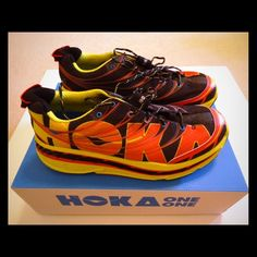 Men's Hoka One One running shoes These Hoka One One Stinson Tarmacs in citrus, red and black were worn only a handful of times and are in an almost new condition. The Stinson's wide and maximally cushioned sole provides a near weightless feel to your step as you run. The neutral support shoe is stable through a massive variety of terrain and returns your energy with a springy rebound. If you're unfamiliar with the brand, check out online reviews- people LOVE these shoes! Hoka One One Shoes…