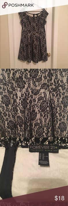 Forever 21 Elegant Lace Dress Beautiful, high quality dress. Cream colored with black lace overlay. Super comfortable but extremely flattering. Only worn 3 times. Fits true to size, zip back (pictured). Forever 21 Dresses