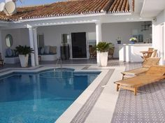 A house by the beach in Spain.  with a pool (and a pool boy)