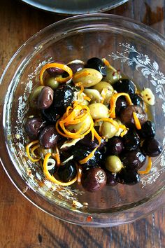 tossing olives with marinade  ~ Judith's comment; as always Allie has a beautiful photo tutorial. I always have an assortment of olives on the buffet table when entertaining.