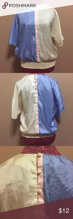 Vintage 1980s Pastel Blouse In very good condition. Made in USA. Style and pastel colors make this probably 1980s. No size label but I would consider this a medium if want to wear it oversized. Mannequin is a size small. Three buttons on the back. Vintage Tops Blouses