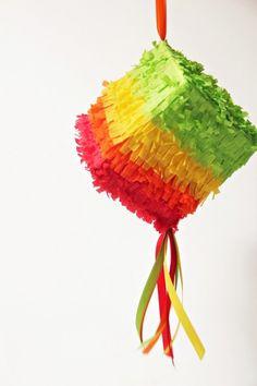 10 Last Minute Cinco De Mayo DIYs: has tutorial on a tissue box piñata(picture), silverware pockets, napkin rings, pinata blindfold, and more.