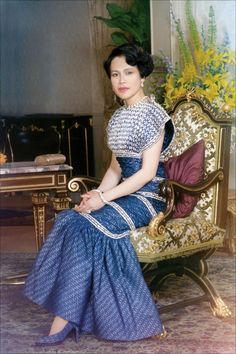 A formal portrait of Her Majesty taken by His Majesty King Bhumibol in Bangkok, Thailand. Her Majesty Queen Sirikit looks elegant in Her silk gown. The dress was made of SUPPORT blue silk ikat (mat mii) woven by members of the SUPPORT Foundation and embroidered with crystal bead and metallic silver thread. It was designed by Erik Mortensen for House of Balmain. Her Majesty also wore this dress for the occasion of Her three-week promotional visit to United States in 1985.