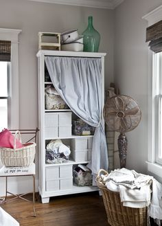 Paint a bookcase and add a simple curtain using a tension rod. Cute vintage-y storage!