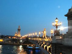 Paris, France - Pont Alexandre III 1896, flowered garlands, extravagant lamps supported by cherubs.