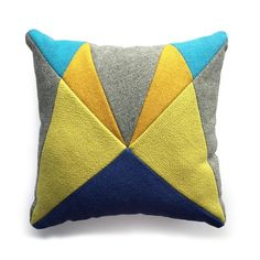 This new 'AU' patchwork cushion has been made using the off cuts from fabrics used in some of my previous upholstery commissions hence 'After Upholstery' and will only be available in very limited numbers. Made using a textural mix of Scottish wools in rich contrasting jewel tones of yellow with hints of turquoise & grey and blue for contrast. These limited edition cushions have a luxurious feel and are perfect to cosy up to on your sofa!Approx 42x42 cm with cushion pad.If you are interested Felt Cushion, Patchwork Cushion, Cushion Pads, Yellow Turquoise, Handmade Pillow Covers, Blue Cushions, Made Goods, Jewel Tones, Soft Furnishings