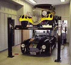 Professional Grade Specialists Since Car Storage - Residential - Commercial - Vehicle Lift Parking Systems. Call us today Garage Lift, Man Cave Garage, Garage House, Garage Shop, Dream Garage, Garage Entry, Garage Bar, Home Car Lift, 4 Post Car Lift