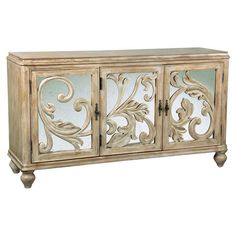 Distressed 3-door credenza with mirrored front panels and scrolling acanthus leaf embellishments.   Product: Credenza