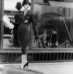 soleil-de-matin:    Anne St. Marie wearing a tweed dress and hat by Christian Dior, 1955