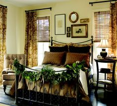 Nell Hills-love the frame collection above the bed, and the Gorgeous greenery swag.