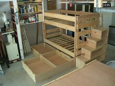 Bunk beds with drawers underneath and stair/bookshelf. Brilliant.