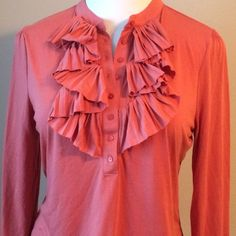 """Talbots Ruffled Top Buttoned Blouse Sz Large Talbots Sz Large Salmon color Long Sleeve Buttoned Top Pleated Ruffled Blouse.  Material: 65% polyester – 35% rayon – machine wash cold.  Length: Top of Shoulder to Bottom of Hem: 25.5"""" Bust: Underarm to Underarm: 21"""" Sleeve: Shoulder to sleeve Talbots Tops"""