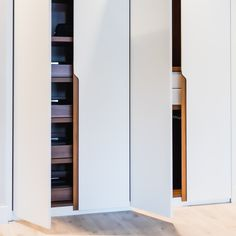 A Neatsmith Trim style wardrobe with contrasting internal wooden drawers and shoe racks. This natural and contemporary look is perfect for a light and bright bedroom or for contrasting with a bold paint or wallpaper colour palette.  Neatsmith designs and installs bespoke wardrobes, dressing rooms and bedroom furniture to create your perfect bedroom that's completely tailored to your needs. #wardrobeideas #dressingrooms #homedecor #bedroom #bedroomideas #bedroominteriors #madetomeasure Bespoke Wardrobes, Veneer Door, Bronze Mirror, Shoe Racks, Shaker Doors, Wooden Drawers, Sliding Wardrobe, Unique Doors, Dressing Rooms
