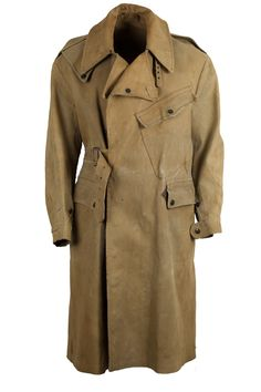 Dated 1948 British army Dispatch rider coat. Made out of a sturdy rubberized cotton cavalry twill material, the jacket was used during WW2 by British military motorcyclists to withstand all kinds of weather. The jacket is in beautiful worn condition with nice wear. Jacket has the typical inclinated chestpocket and is loaded with amazing details. A true designers piece. Please note that this jacket is over 70 years old, the rubberized cotton has some odor
