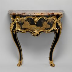 c1755-60 Maker:Bernard II van Risenburgh (ca. 1696–ca. 1767) Date:ca. 1755–60 Culture:French, Paris Medium:Oak and pine lacquered black and veneered with Japanese black and gold lacquer; gilt-bronze mounts; Sarrancolin marble top Dimensions:H. 35-1/2 in. (90.2 cm.), W. 37-1/2 in. (95.3 cm.), D. 21 in. (53.3 cm.). Met Museum