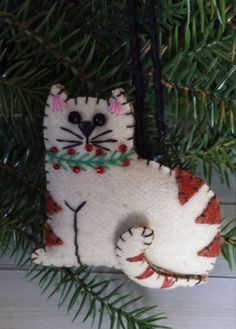 Felt cat Christmas ornament with beaded accents. Great gift for cat lovers