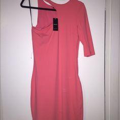 One shoulder pink BEBE dress Pink one shoulder dress with a three quarter sleeve. Be pretty in pink! bebe Dresses