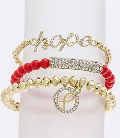 Beautiful, three-piece bracelet set with beaded bands, one with a crystal studded hope in script, another with a crystal studded bar divider and the third with a...
