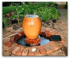 newly built fountain DIY How to Make a Garden Fountain, using a kiddie pool as opposed to an expensive basin