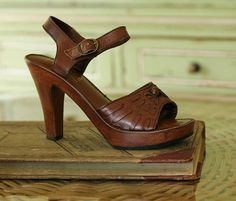 """vintage stacked wood heels with buckle closure and open toe. man made materisl. 1"""" platform sole with 4.5"""" heel. Made by Imperial."""