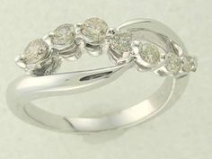 ($559.00) Beautiful genuine Diamond Ring, in the very popular Journey style to commemorate lifes most precious moments.