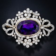 This regal, ravishing and quite sizable Victorian brooch and pendant combo radiates with a luscious deep purple Siberian amethyst, weighing 17.75 carats. The majestic gemstone is set in a yellow gold bezel and is fancifully framed in sparkling flowers and flowing ribbons of old mine-cut diamonds. This magnificent jewel is finely handcrafted in platinum over 18 karat yellow gold and is fitted with its original removable pin mechanism. Fit for a Queen! French hallmarked.