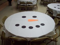 Super easy table decorations for my Girl Scout Christmas party... white tablecloth with construction paper circles and carrot.