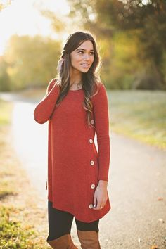 Our Button Detail Sweater Tunic Dress is the Fall & Winter essential every woman needs! Featuring a flattering asymmetrical cut, with darling wood button details, and long sleeves, this sweater dress will keep you cozy and put together all season long!