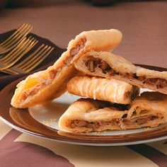 "Pecan Kringle Sticks - ""My family loves this Kringle's flakiness and that it's not too sweet; it just melts in your mouth. It makes a beautiful presentation on a cookie platter, cut on an angle along with other holiday sweets."""