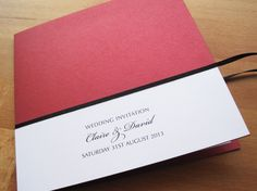 Manhattan Wedding Invitation in red and white and finished with black ribbon.