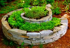 Stone herb spiral sculpture www.homeharvest.biz