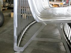 Cutout_public urban bench made of a single bended metal sheet to create a 360 degrees of human activity. Manufactured by Urbo