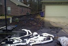"""Oily areas between homes in Mayflower. Residents described the oil as smelling """"acrid"""" or """"like burning tires.""""  Source: EPA"""