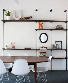 Industrial shelves, MCM table and Eames chairs... Ahhhhh... Does it get any better?