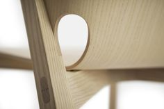 'pelt' is a chair made from a thin 8mm plywood shell that wraps around a solid ash frame. conceived by benjamin hubert  for furniture brand de la espada, the seating design extends downwards through the front legs making it appear as a seamless unit,  integrated with the solid frame beneath. the front and rear legs of the chair are linked via a simple cross construction which  offers overall stability and support.